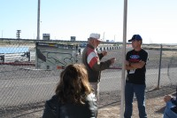 Bill Walker provides track instruction to Boss 302 driver Mike Garcia